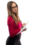 Image of woman in red taking notes stock photo