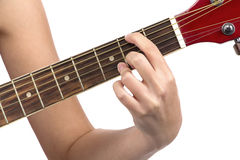 Image of woman's fingers on guitar Royalty Free Stock Photography