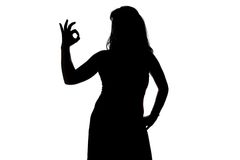 Image of woman's silhouette showing okey Royalty Free Stock Photo