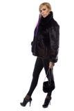 Image of woman in short fur coat with handbag Royalty Free Stock Image