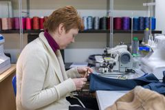 Woman tailor at work in the atelier. Image of woman tailor at work in the atelier royalty free stock photo
