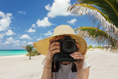 Image of woman taking pics with a camera. Royalty Free Stock Photo