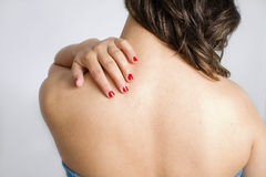 Neck and bak. An image of a woman touching her neck stock image