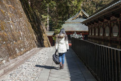 Image of Woman walk alone in Nikko Nation park,Japan. Stock Photo