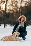 Image of woman on walk with dog on background of trees in winter. Park at afternoon Royalty Free Stock Photos
