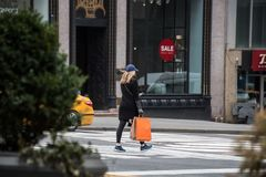 Female shopper walking in New York City Stock Photography
