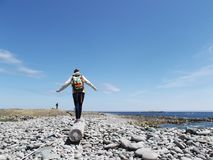 Woman walking on a Driftwood Log on the Beach royalty free stock photos