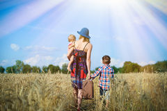 Image of woman wearing hat with baby girl walking Royalty Free Stock Photo