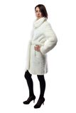 Image of woman in white coat, half turned Royalty Free Stock Photo