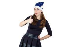 Image of woman in xmas hat with thumb Stock Photo