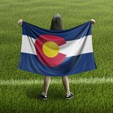 Women and Colorado flag. Image of Women and Colorado flag royalty free stock images