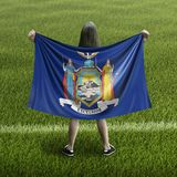 Women and New York flag royalty free stock photo