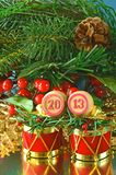 An image of wooden bingo kegs with numbers of coming new year Stock Photos