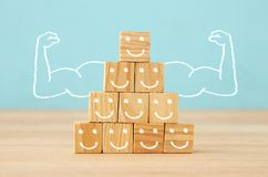 Image of wooden blocks with people icons over table ,building a strong team, human resources and management concept. Stock Photo