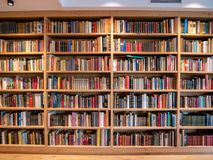 Image of wooden book shelf with books. In library royalty free stock photo