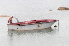 Wooden fishing boat anchored royalty free stock photo