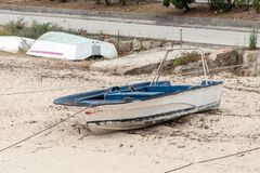 Wooden fishing boat anchored stock photos