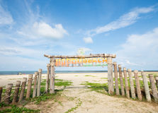 An image of wooden gate on the beach in blue sky and some clouds Stock Photos