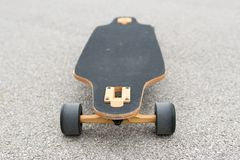 Image of wooden longboard with black surface. Street transportation. royalty free stock photography