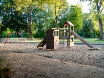 Image of wooden playgound on sandy ground stock photos