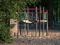 Image of wooden playgound on sandy ground stock photography