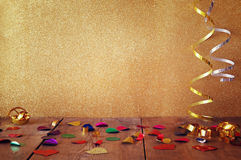 Image of wooden table with colorful confetti Stock Image