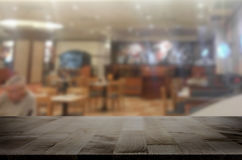 image of wooden table in front of abstract blurred background of