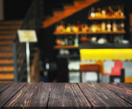 Image of wooden table in front of abstract blurred background of restaurant interior. can be used for display or montage your prod Royalty Free Stock Image