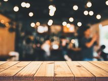 Image of wooden table in front of abstract blurred restaurant li royalty free stock photo