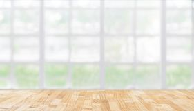Image of wooden table in front of abstract blurred restaurant li