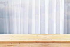 image of wooden table in front of blurred window light royalty free stock photos