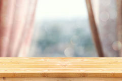 image of wooden table in front curtains. for product display and presentation royalty free stock photo