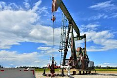 Working Oil Well Pump Jack stock photography