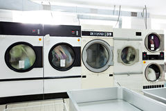 Image of working washing machines in laundry room Stock Images