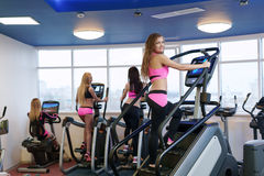 Image of workout in gym. Cute girl poses at camera Stock Photography