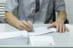 Writing doctor`s hands royalty free stock image