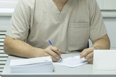 Writing doctor`s hands royalty free stock images