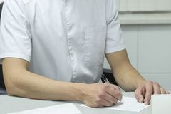 Writing doctor`s hands royalty free stock photo