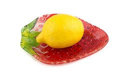 Image of yellow lemon on plate Royalty Free Stock Images