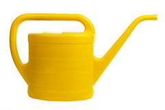 Yellow watering can on white background Royalty Free Stock Image