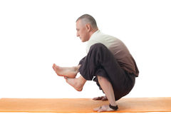 Image of yoga instructor posing in difficult asana Stock Image