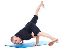 Image of yogi posing in studio looking at camera Stock Image