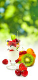 image of yogurt in a glass with fruit on a white background close up Stock Images