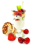 image of yogurt in a glass with fruit on a white background close up Stock Image