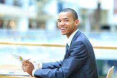 Image of young African man looking at camera Stock Photos