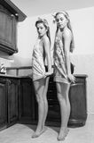 Image of young beautiful funny women pinup girls in dancing first position at the kitchen bar black & white image Stock Photo