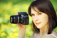 Image of young beautiful woman photographing in summer park Stock Photography