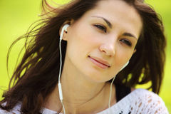 Image of young beautiful woman in summer park enjoy music Royalty Free Stock Images