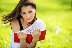 Image of young beautiful woman in summer park reading a book Royalty Free Stock Photography