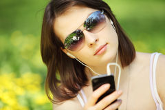 Image of young beautiful woman in summer park reading a message Stock Photos
